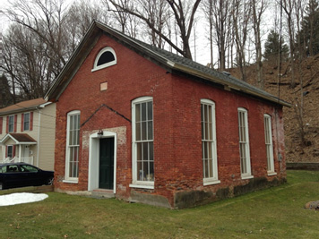 1800's church revitalized with new roof, rebuilt foundation and new structural floor framing.